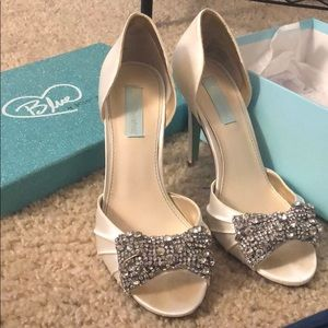 Blue by Betsy Johnson, embellished white heels.